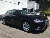 Racy yet refined, this 2013 Audi A4 will envelope you