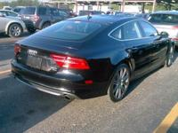 This is a Audi A7 for sale by Empire Exotic Motors. The