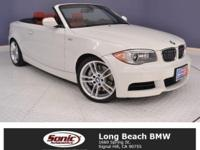 Step inside our BMW '13 Alpine White 135i Convertible,