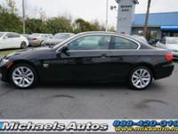 BMW 328xi Coupe with Navigation. Saddle Brown Leather.