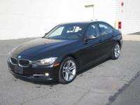 You are looking at a beautiful black on black, 2013 BMW
