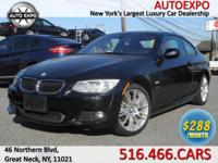This luxurious 2013 BMW 335I XDrive M Sport Coupe comes