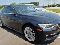 This 2013 BMW 3 Series 4dr 328i Luxury Sedan features a