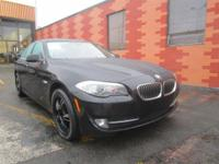 Solid and stately, this 2013 BMW 5 Series turns even