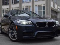 This BMW M5 is ready and waiting for you to take it