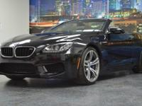 This is a BMW, M6 for sale by Empire Exotic Motors. The