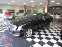 This lavish 2013 Cadillac ATS features a black diamond