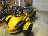 This is a 2013 Can Am Spyder STS - SE5 (automatic
