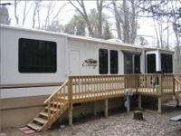 This 2013 Cedar Creek Cottage Explorer 40CFE has about