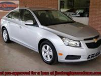 2013 Chevy Cruze LT Pre-Owned. When I open the doors to