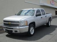 You are looking at a silver, 2013 Chevrolet Silverado.