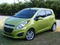 This outstanding example of a 2013 Chevrolet Spark LT