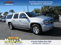 This 2013 Chevrolet Suburban 1500 LT in Silver Ice