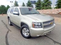 Our gorgeous 2013 Chevrolet Tahoe LT 4WD shown in Gold