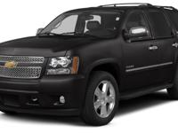 This 2013 Chevrolet Tahoe LTZ boasts features like a