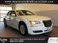 This 2013 Chrysler 300 in Ivory Tri-Coat Pearl