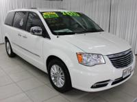 This 2013 Chrysler Town & Country Limited is proudly