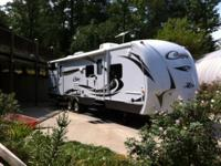 Selling our BRAND NEW 2013 Cougar 32FT travel trailer.