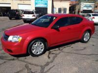 This 2013 Dodge Avenger has a L4, 2.4L high output