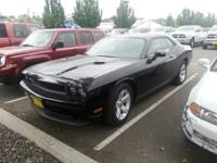 This exceptional example of a 2013 Dodge Challenger SXT