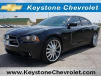 This outstanding example of a 2013 Dodge Charger RT is