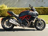 2nd owner Diavel Carbon Red with over $12000 in