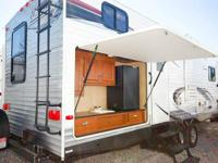 The bunk room features bunk beds with trundle bed and a