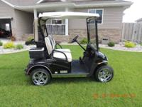 For sale: 2013 E-Z-Go Freedom RXV golf cart. The cart