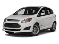 HYBRID/ AUXILIARY JACK. The 2013 Ford C-Max Hybrid is