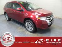 This 2013 Ford Edge SEL is Ruby Red Metallic Tinted