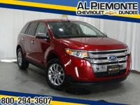 This Ruby Red Metallic 2013 Ford Edge Limited with