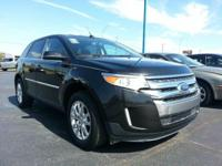 2013 Ford Edge Limited is a mid-size SUV with front