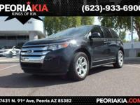 This is a 2013 Ford Edge SE. It has a black exterior