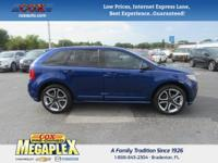 This 2013 Ford Edge Sport in Deep Impact Blue Metallic