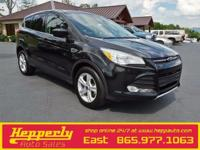 This 2013 Ford Escape SE in Black features. Odometer is