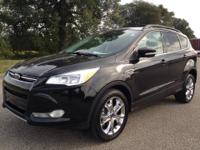 Exterior Color: tuxedo black, Body: SUV, Engine: 1.6L