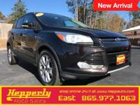 This 2013 Ford Escape SEL in Tuxedo Black features.