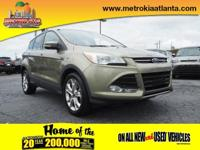 This 2013 Ford Escape SEL includes a braking assist,