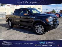 Cloth front bucket seats, navigation, backup camera,
