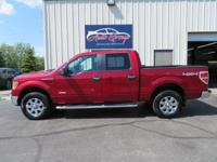 Our 2013 Ford F-150 XLT SuperCrew 4x4 shown in Ruby Red
