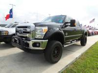 This 2013 Ford Lariat 4x4 SD Crew Cab 6.75 ft. box 156