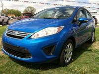 Energy-efficient and gas-sipping, this 2013 Ford Fiesta
