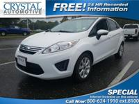 -Great Gas Mileage- This 2013 Ford Fiesta SE is White.