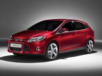 2013 Ford Focus SE in Black custom features include.,