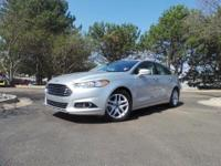 This Fusion is equipped with Heated Leather Seats,
