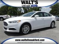Pre-owned 2013 Ford Fusion SE. Low Miles and features
