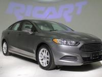 2013 Ford Fusion SE. 6-Speed Automatic. Sticks to the