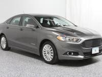 This 2013 Ford Fusion Hybrid has a sharp Ingot Silver