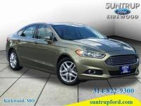 This 2013 Ford Fusion SE is complete with top-features