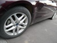 This front wheel drive used 2013 Ford Fusion SE